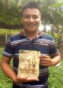 Village health promoter Werner Obeníel with his deceased father's 35-year-old, dog-eared copy of Donde No Hay Doctor.