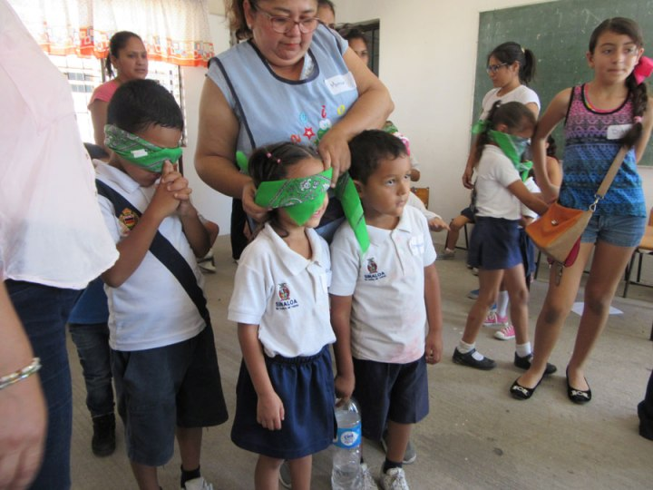 mothers blindfold children to simulate disability