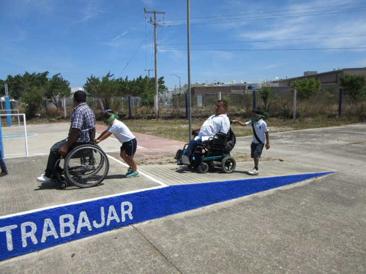 wheelchair riders lead 'blind' children