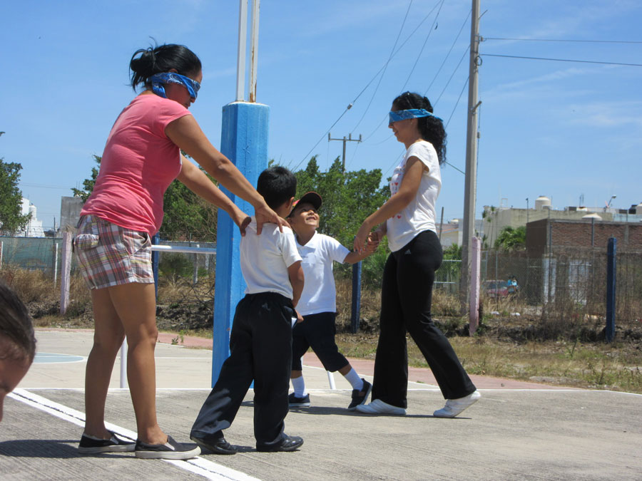 children lead their blindfolded mothers.