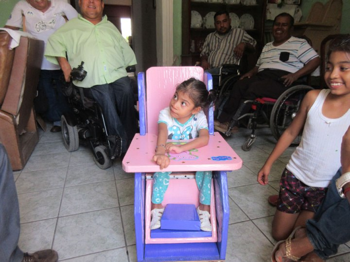 The addition of a cardboard foot separator holds her knees bent and her feet in a better position.
