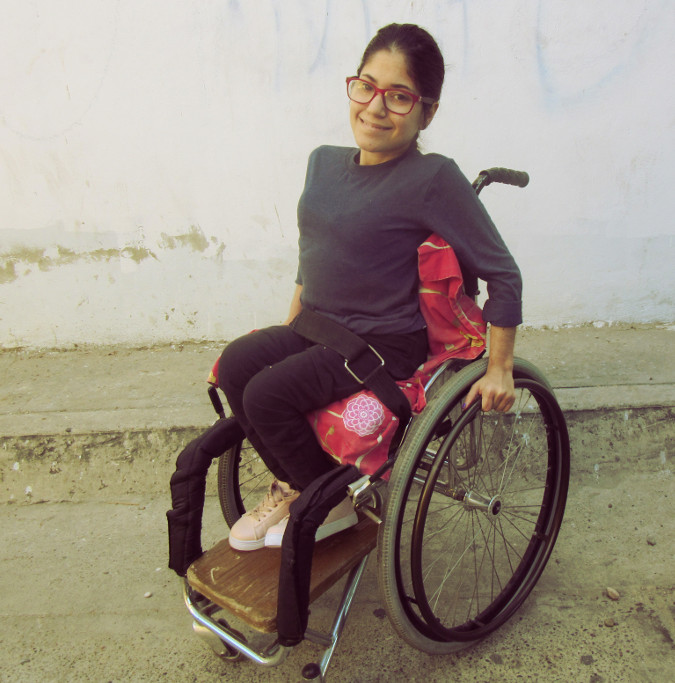 Mónica, her molded cardboard cushion in place, sits on her wheelchair adapted to her specific needs