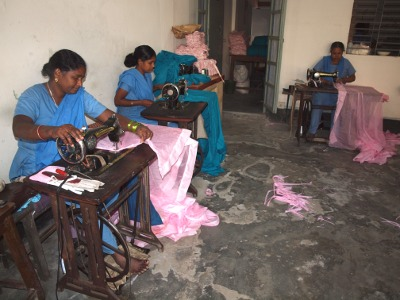 GK trains and gives jobs to thousand of single illiterate mothers. This tailoring shop is headed by a disabled woman.